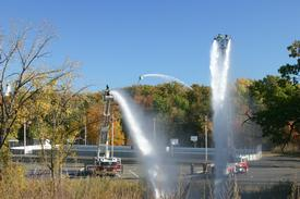 Hudson Tower Ladder 32, Stottville Ladder 50, and Catskill Tower 3-15 (l-r) operate on Sunday, October 12th at a mutual aid drill at Oakdale Lake in Hudson. (photo by Neal Van Deusen)