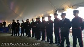 Members of the Dive Team stand together as the award is read aloud to the audience.