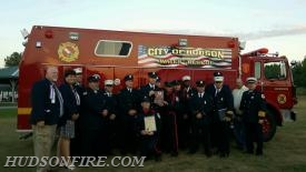 """Dive Team members pose with the CCVFA """"Firefighter of the Year Award"""" Committee."""