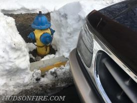 Fortunately this hydrant had been cleared of snow. Unfortunately a car was parked in front of it.