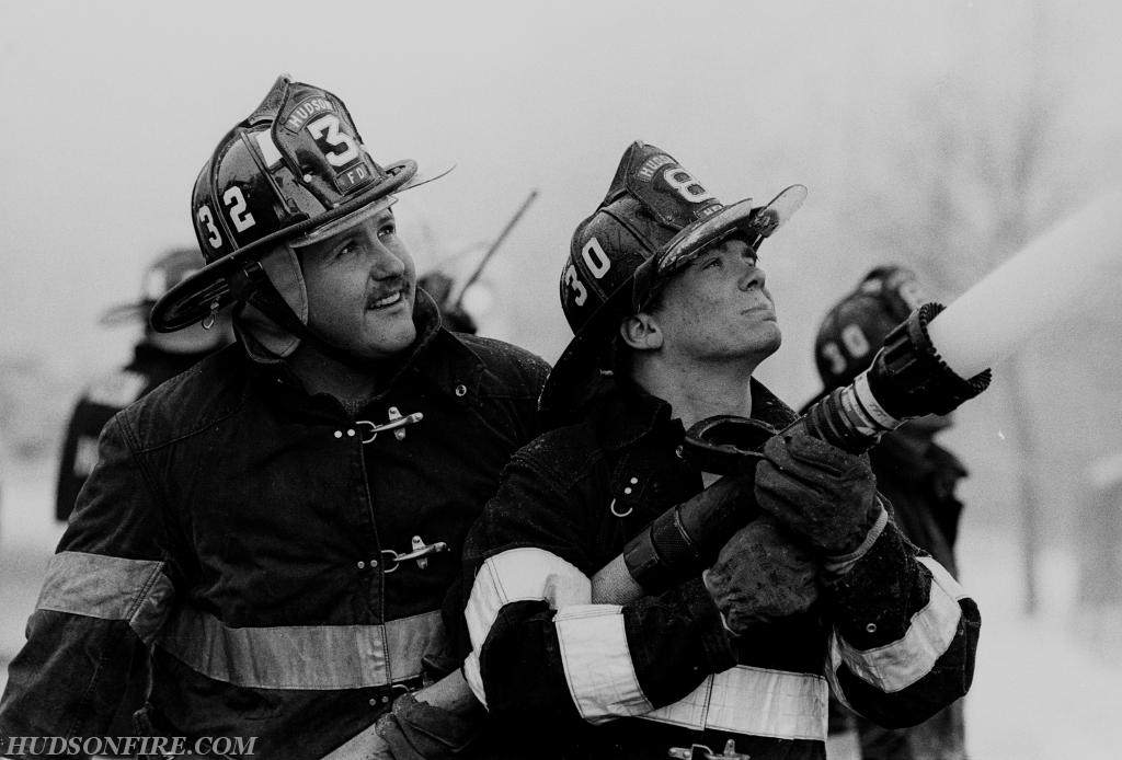 City of Hudson firefighter Mark Graziano (on the nozzle) with firefighter Pete Wrigley at the Charlie's Corner fire at 5th & Warren Streets on February 25, 1990. (photo by BJ Pendergast)