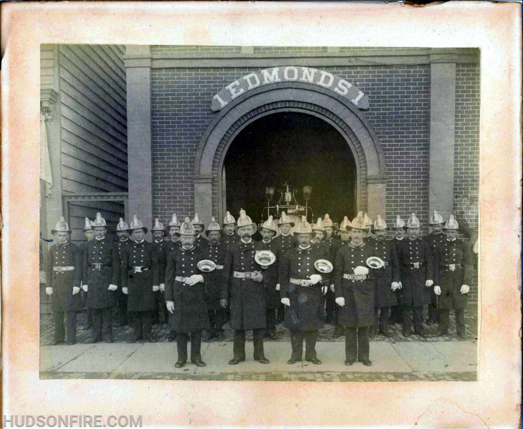 J. W. Edmonds Hose Company, No. 1 firefighters in front of their Park Place firehouse in the mid 1800s.