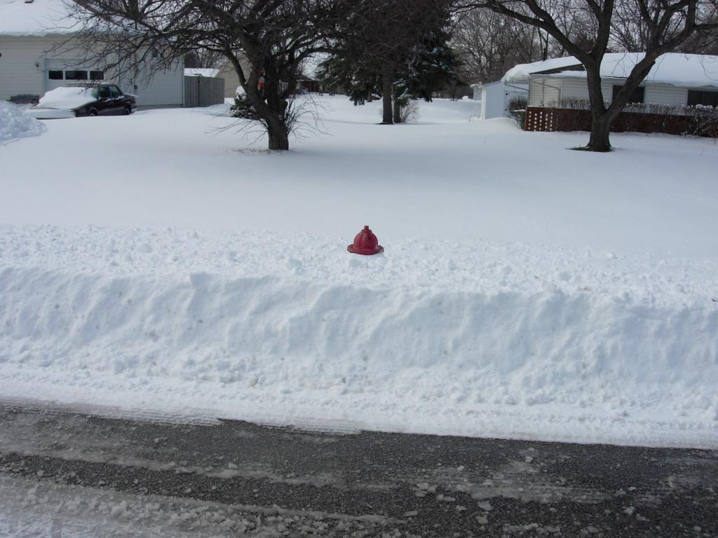 Even though the top of this hydrant is visible, firefighters still have to remove snow from around this hydrant to allow them to connect hoses.
