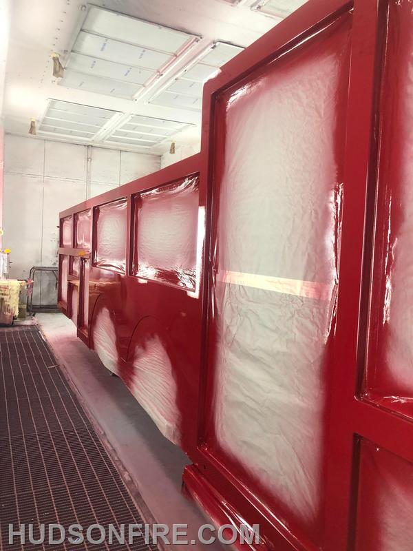 Passenger side of the body drying in the paint booth