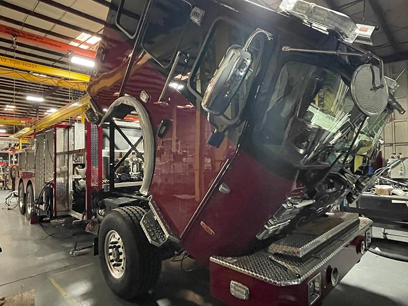 Passenger Side Front-An interesting addition by the committee are the grab handles placed just above the headlights. The handles were installed for members to safely perform cleaning and maintenance on the front of the apparatus without damaging other equipment.